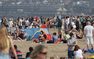 Rain and fresher weather after UK records its third hottest day ever