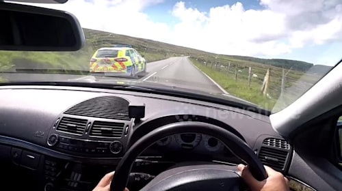 'I promise I'm not breaking the speed limit!' Driver overtakes police at 125 mph in Isle of Man