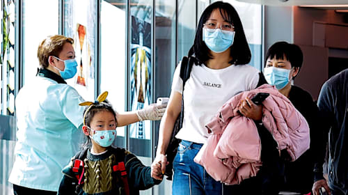 China locks down 10 cities as coronavirus death toll rises