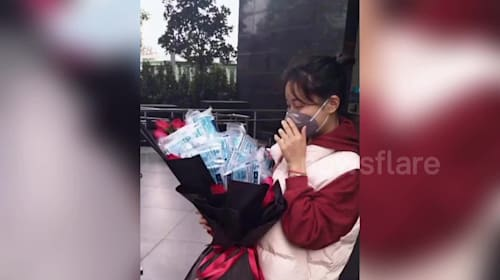 Chinese girl receives bunch of flowers packed with masks and ethyl on Valentine's Day