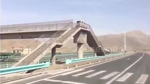 Driver tries motorway U-turn by taking car up pedestrian bridge