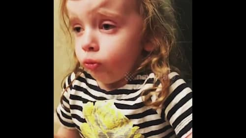 Four-year-old US girl tries extremely hard to enjoy her mum's cooking