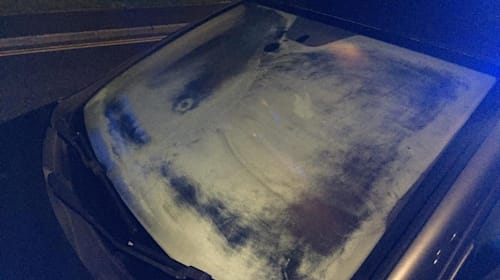 Police pull over driver whose windscreen was so frosty he 'may as well have been blindfolded'