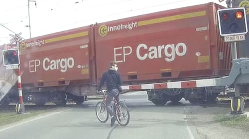 Impatient cyclist almost hit by train