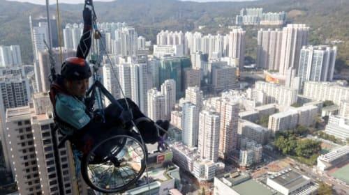 In wheelchair, paraplegic Lai Chi-wai climbs up skyscraper in Hong Kong