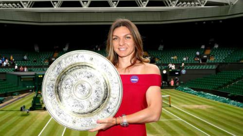 Champion Halep plans Wimbledon return as she wears membership badge of honour