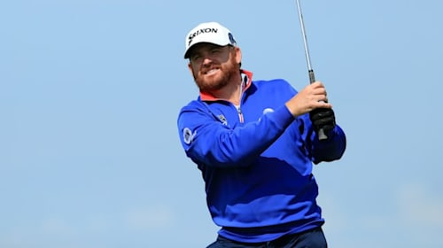 Holmes takes surprise Open lead on a day of misery for McIlroy and Woods