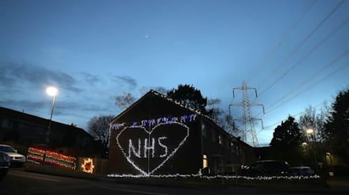 Family uses Christmas lights to decorate their house in tribute to NHS