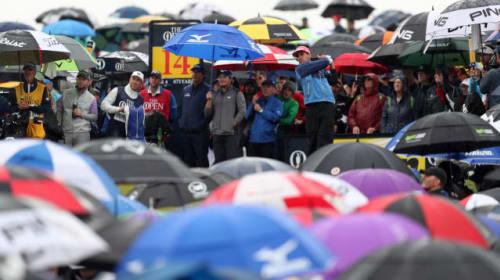 Sea of umbrellas as golf fans brave rain at Open