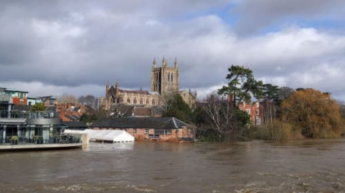 Woman swept away by floodwater is found dead
