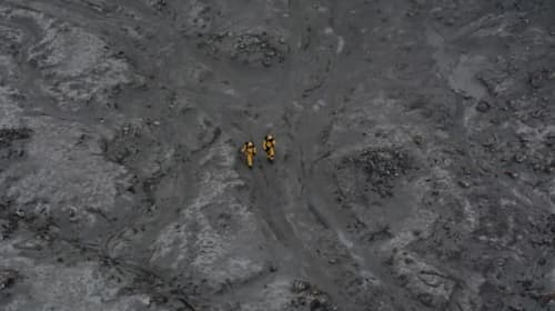 Navy and police divers continue search for body after New Zealand volcano