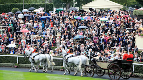 Queen braves downpours to join thousands at Royal Ascot