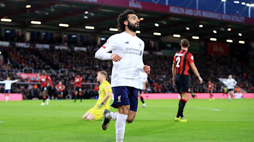 Runaway leaders Liverpool brush aside Bournemouth