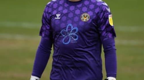 Newport keeper Tom King scores from goal kick against Cheltenham