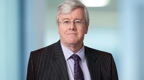 Tesco chairman defends bonus cuts for shop floor staff at AGM