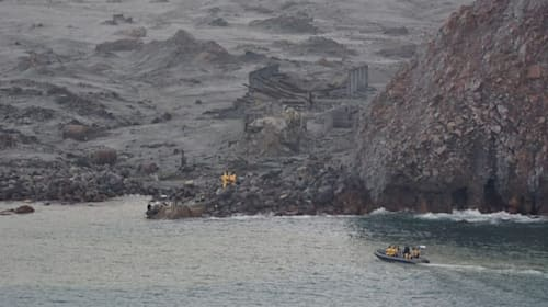 Divers in near zero visibility attempt to find victims of New Zealand volcano