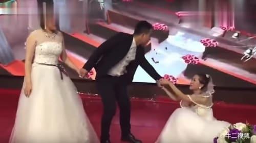 新郎の元恋人がウェディングドレス姿で結婚式に乱入するハプニング!【映像】