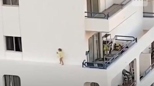 あわや転落・・・マンションの外壁を歩く少女【映像】