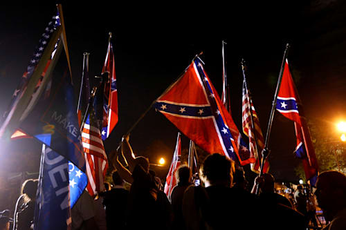 Protesters chant Nazi phrases, wield torches near
