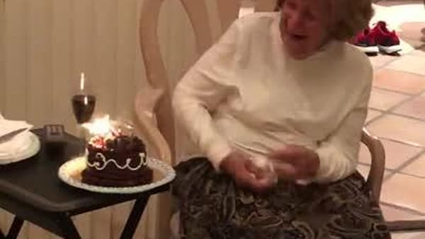 Grandma Tries To Blow Out Trick Candles On Cake