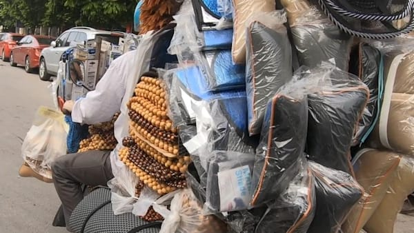 These overloaded motorcycles in Vietnam carry mind-blowing loads of stuff