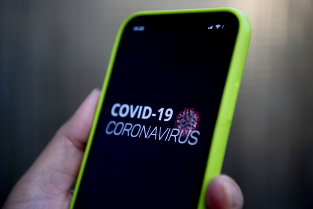 NETHERLANDS - 2020/04/08: In this photo illustration, a COVID-19 coronavirus related app displayed on a mobile phone. The Dutch government plans to use the covid app to trace people who might get in contact with people who are diagnosed with the coronavirus if they leave their house. They will receive a message alert informing them to stay home for 2 weeks. This will be done to curb the spread of covid-19. (Photo Illustration by Robin Utrecht/SOPA Images/LightRocket via Getty Images)