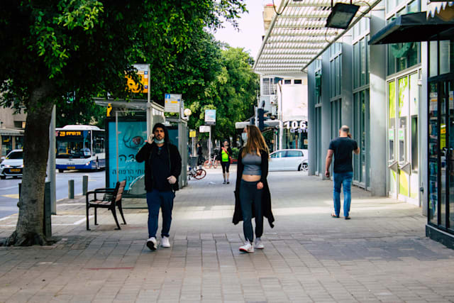 Tel Aviv Israel April 07, 2020 View of unidentified people walking in the empty streets of Tel Aviv during the quarantine of the population to prevent the spread of the coronavirus