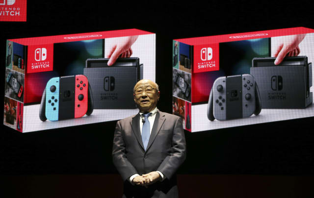 President of Nintendo Tatsumi Kimishima speaks during a presentation event of the new Nintendo Switch in Tokyo, Friday, Jan. 13, 2017. Nintendo Co. said Friday that its Nintendo Switch video game console will sell for 29,980 yen (about $260) in Japan, starting March 3. (AP Photo/Koji Sasahara)