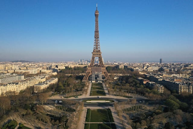 An aerial view shows the deserted Champs de Mars near the Eiffel tower in Paris during a lockdown imposed to slow the spread of the coronavirus disease (COVID-19) in France, April 2, 2020. Picture taken with a drone April 2, 2020. REUTERS/Pascal Rossignol