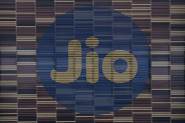 The logo of JIO is seen at the facade of the Jio World Centre, in Navi Mumbai on April 22, 2020. - Facebook has taken a $5.7 billion stake in the Jio digital platforms business of India's richest man Mukesh Ambani, the two sides said on April 22, marking one of the biggest foreign investments in the country. The deal will give the US social media giant a 10 percent stake in Jio Platforms, part of Ambani's Reliance Industries empire. (Photo by INDRANIL MUKHERJEE / AFP) (Photo by INDRANIL MUKHERJEE/AFP via Getty Images)