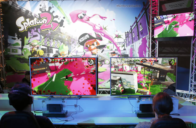 """PARIS, FRANCE - JANUARY 13: Visitors play the """"Splatoon 2"""" video game on a Nintendo Switch games console during the new console's unveiling by Nintendo Co on January 13, 2017 in Paris, France. This next-generation game console, billed as a combination of a home device experience and a portable entertainment system, will be available for $ 299.99 in the US from March. (Photo by Chesnot/Getty Images)"""