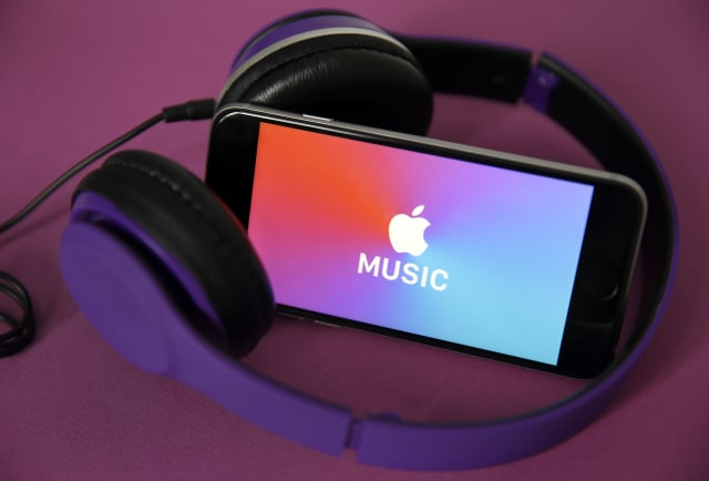 PARIS, FRANCE - APRIL 08: In this photo illustration, the logo of the music streaming platform Apple Music is displayed on the screen of an iPhone on April 08, 2019 in Paris, France. The number of paying subscribers to the music streaming service of Apple Music has for the first time exceeded that of Spotify customers in the US. The two platforms now have 28 and 26 million paying users, respectively, sources told the Wall Street Journal. (Photo by Chesnot/Getty Images)