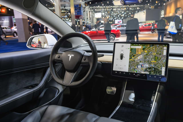 BRUSSELS, BELGIUM - JANUARY 09: Tesla Model 3 compact full electric car interior with a large touch screen on the dashboard on display at Brussels Expo on January 9, 2020 in Brussels, Belgium. The Model 3 is fitted with a full self-driving system. (Photo by Sjoerd van der Wal/Getty Images)