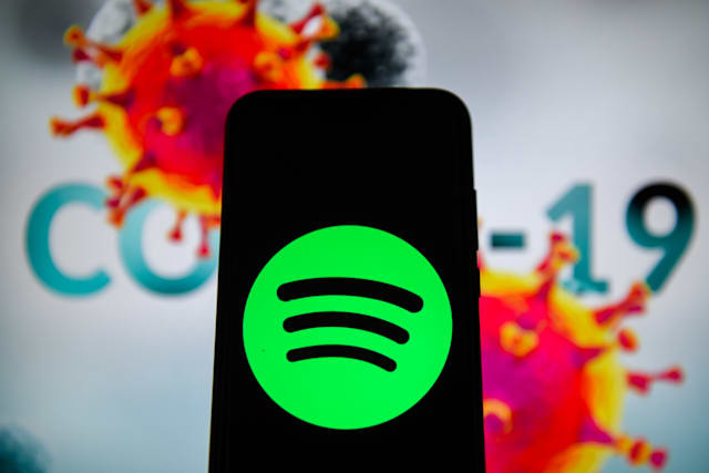 POLAND - 2020/04/10: In this photo illustration a Spotify logo is seen displayed on a smartphone with a COVID 19 sample on the background. (Photo Illustration by Omar Marques/SOPA Images/LightRocket via Getty Images)