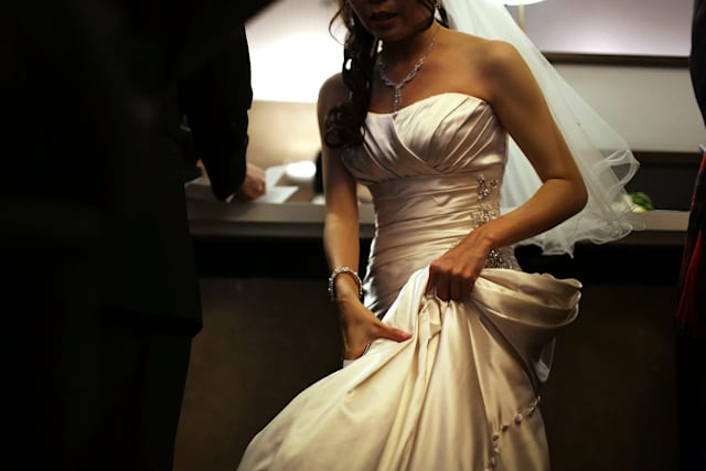 NEW YORK, NY - DECEMBER 12: A bride waits to fill out marriage papers at a busy City Clerk's office on December 12, 2012 in New York City. Couples around the world are hoping that a once-in-a-lifetime event, the date 12/12/12, will bring added luck to their marriages if they tie the knot today. This will be the last such triple date for almost a century, until January 1, 2101. (Photo by Spencer Platt/Getty Images)