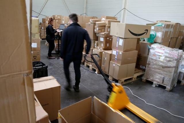 An employee prepares an order for Amazon at Porona warehouse in Bruay-sur-l'Escaut near Valenciennes, France, April 22, 2020. Picture taken, April 22, 2020. REUTERS/Pascal Rossignol