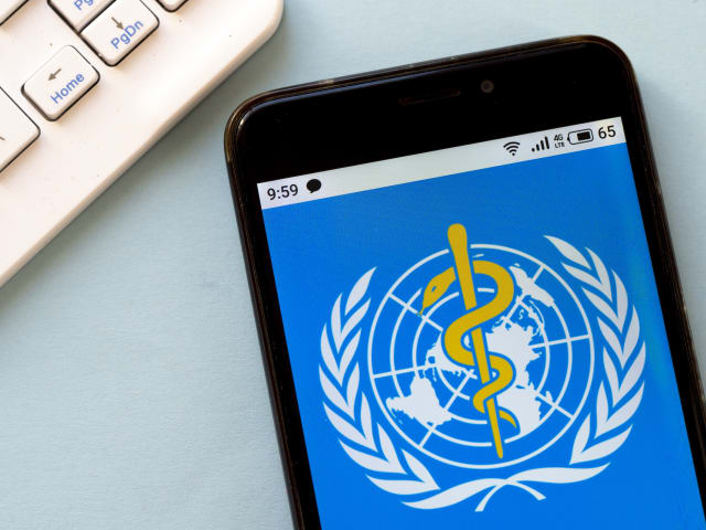 KIEV, UKRAINE - 2020/03/16: In this photo illustration the World Health Organization logo is seen displayed on a smartphone. (Photo Illustration by Igor Golovniov/SOPA Images/LightRocket via Getty Images)