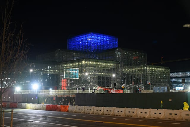 NEW YORK, NY - APRIL 09: The temporary hospital at Jacob K. Javits Convention Center is illuminated in blue lights during the coronavirus pandemic on April 09, 2020 in New York City. Landmarks and buildings across the nation are displaying blue lights to show support for health care workers and first responders on the front lines of the coronavirus (COVID-19) pandemic. (Photo by Noam Galai/Getty Images)