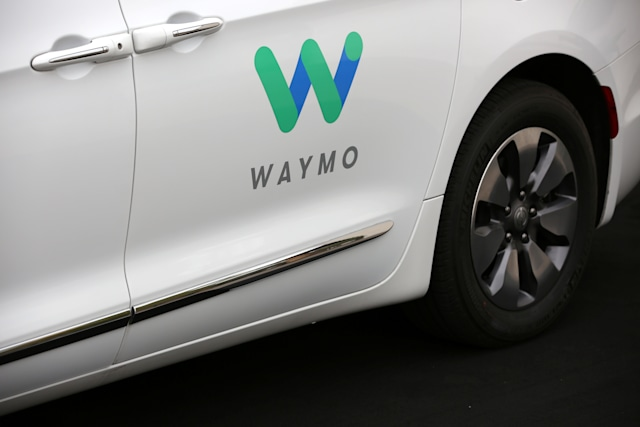 A Waymo Chrysler Pacifica Hybrid self-driving vehicle is parked and displayed during a demonstration in Chandler, Arizona, November 29, 2018.  REUTERS/Caitlin O'Hara