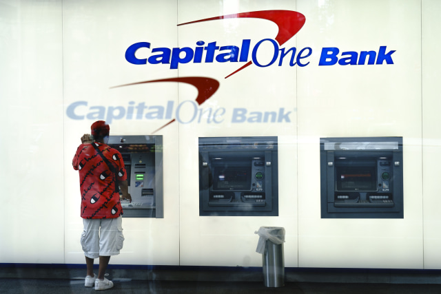 NEW YORK, NY - JULY 30: A man uses the ATM at a Capital One bank in Midtown Manhattan on July 30, 2019 in New York City. In one of the largest-ever thefts of bank data, a software engineer in Seattle was arrested for hacking into a Capitol One server and obtaining the personal data of over 100 million people. The data includes social security numbers, bank account numbers, names, addresses, credit scores, credit limits, balances, and other information. (Photo by Drew Angerer/Getty Images)