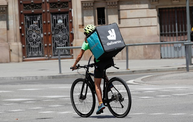 A biker wearing a Deliveroo backpack drives in the central Barcelona, Spain, July 23, 2019. REUTERS/Albert Gea