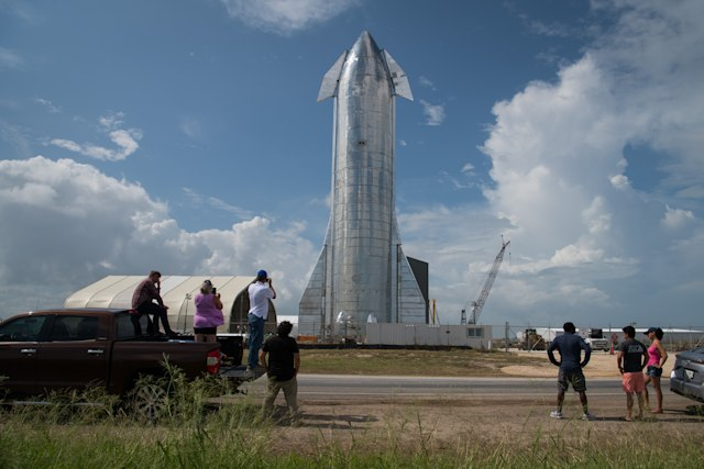BOCA CHICA, TX - SEPTEMBER 28: Space enthusiasts look at a prototype of SpaceX's Starship spacecraft at the company's Texas launch facility on September 28, 2019 in Boca Chica near Brownsville, Texas. The Starship spacecraft is a massive vehicle meant to take people to the Moon, Mars, and beyond. (Photo by Loren Elliott/Getty Images)