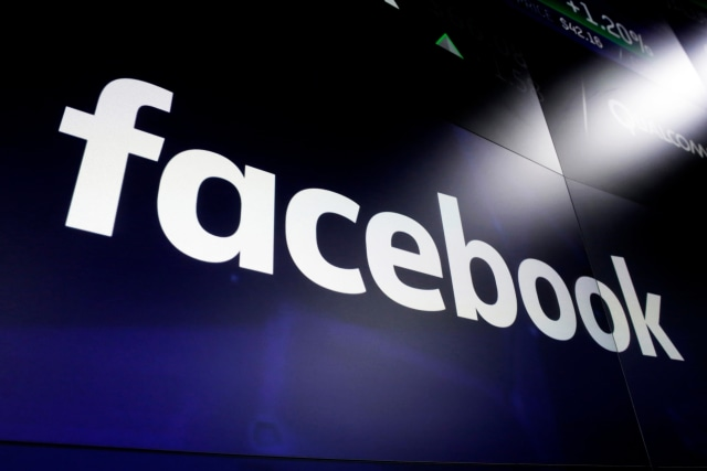 """FILE - In this March 29, 2018 file photo, the Facebook logo on a screen at Nasdaq in Time Square, New York. Facebook and its partners have asked financial authorities in Switzerland to evaluate their plan to create a new digital currency called Libra. Facebook has said a nonprofit association headquartered in Geneva would oversee Libra, putting it under Swiss regulatory authority. The Swiss Financial Market Supervisory Authority said Wednesday, Sept. 11, 2019 the Libra Association has requested an """"assessment"""" of its plan. (AP Photo/Richard Drew, file)"""