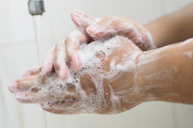 Close Up Of Medical Staff Washing Hands. Hand hygiene.