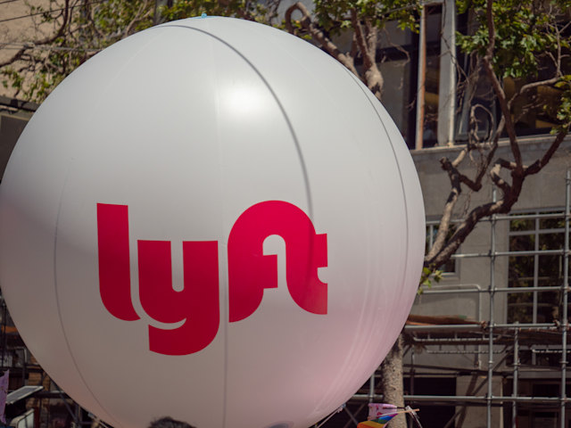 SAN FRANCISCO, CA JUNE 23, 2018: Large white Lyft balloon waving in an urban setting