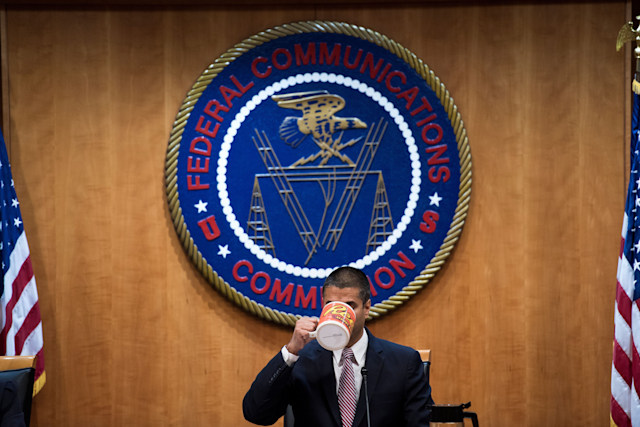 FCC Chairman Ajit Pai listens during a hearing at the Federal Communications Commission on December 14, 2017 in Washington, DC. / AFP PHOTO / Brendan Smialowski        (Photo credit should read BRENDAN SMIALOWSKI/AFP via Getty Images)