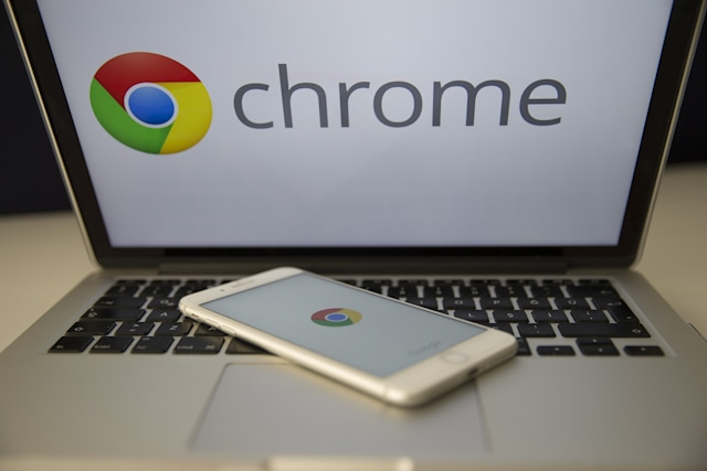 ANKARA, TURKEY - SEPTEMBER 02: Logos of Google Chrome are seen on the screens of smart phone and laptop in Ankara, Turkey on September 02, 2018.  (Photo by Gokhan Balci/Anadolu Agency/Getty Images)