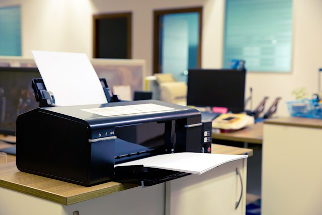 Laser Printer on the table in Office.