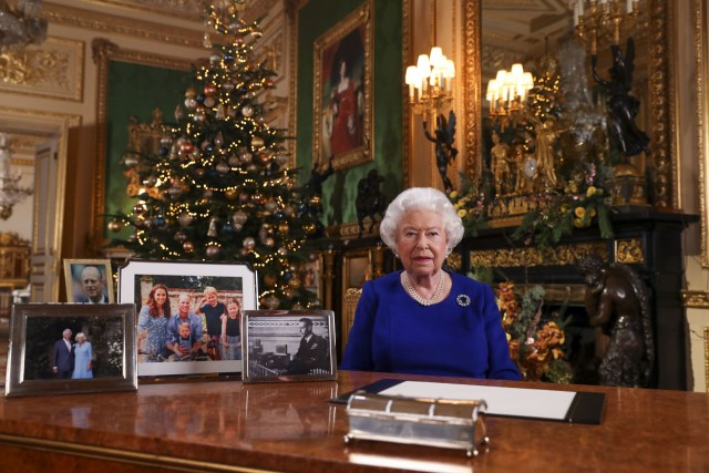 "A picture released on December 24, 2019 shows Britain's Queen Elizabeth II posing for a photograph after she recorded her annual Christmas Day message, in Windsor Castle, west of London. - During her traditional Christmas address, Queen Elizabeth II intends to call on the British to overcome their divisions after a year ""full of pitfalls"", between Brexit tearing apart her country and scandals shaking the British royal family, according to extracts from the address broadcast in advance. (Photo by Steve Parsons / POOL / AFP) (Photo by STEVE PARSONS/POOL/AFP via Getty Images)"