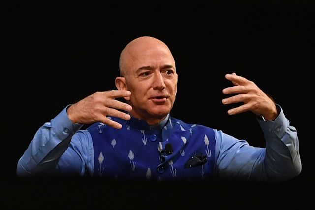 CEO of Amazon Jeff Bezos (R) gestures as he addresses the Amazon's annual Smbhav event in New Delhi on January 15, 2020. - Bezos, whose worth has been estimated at more than $110 billion, is officially in India for a meeting of business leaders in New Delhi. (Photo by Sajjad HUSSAIN / AFP) (Photo by SAJJAD HUSSAIN/AFP via Getty Images)